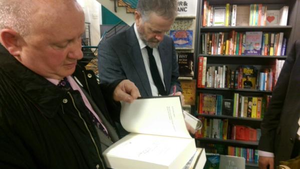 Maurice Walsh signing copies of Bitter Freedom at the launch in Dublin